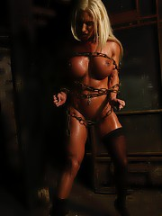 Female muscle pornstar Ashlee Chambers finds herself bound in our dungeon.