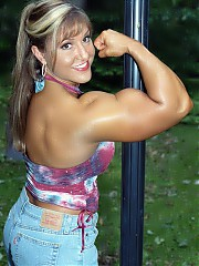 Gina Davis is 33 years of age in contest shape, she is awesome, with a highly developed physique (wi...