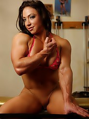 BrandiMae's posing naked, showing what bodybuilding at the gym has done for her big biceps and her m...